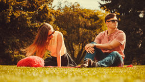 Moody girl with boyfriend in park. Stock Photography