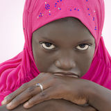 Moody girl wearing a pink headscarf, ten years old Royalty Free Stock Photos