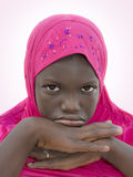 Moody girl wearing a pink headscarf, ten years old Royalty Free Stock Photography