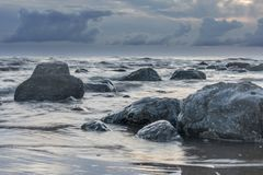 Moody grey seascape background, rock in the Irish Sea at Seascal Stock Photography