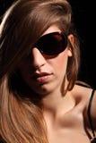 Moody headshot beautiful young woman in sunglasses Stock Image