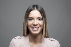 Moody horizontal portrait of young beautiful woman with healthy white teeth smiling Royalty Free Stock Photo