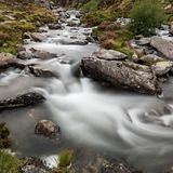 Moody landscape image of river flowing down mountain range near. Landscape image of river flowing down mountain range near Llyn Ogwen and Llyn Idwal in Snowdonia stock images