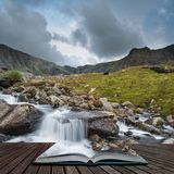 Moody landscape image of river flowing down mountain range near Llyn Ogwen and Llyn Idwal in Snowdonia in Autumn coming out of. Landscape image of river flowing royalty free stock photos
