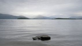 Moody loch lake atmospheric grey clouds dark water Lomond Scotland highlands landscape scene outdoors. Uk Royalty Free Stock Photography