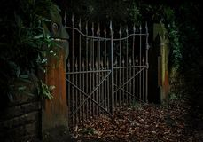 Moody, low-key Photo of Rusty Iron Gates Ajar Royalty Free Stock Photography