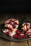 Moody natrual lighting images of fresh juicy pomegranate with vi Stock Photography