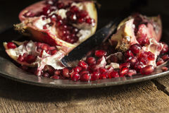 Moody natrual lighting images of fresh juicy pomegranate with vi Royalty Free Stock Photos