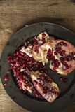 Moody natrual lighting images of fresh juicy pomegranate with vi Stock Image