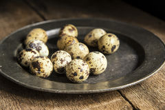 Moody natural lighting vintage retro style image of quaills eggs Stock Photo