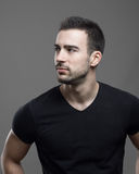 Moody profile of serious masculine athletic man looking away Stock Image