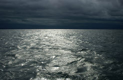 Moody sea. A moody sea churns under a dark sky stock photography
