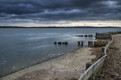 Moody sea landscape looking across Solent to Isle of Wight in En Royalty Free Stock Photo