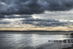 Moody sea landscape looking across Solent to Isle of Wight in En Stock Photo