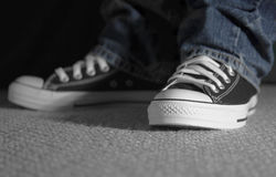 Moody shoes. Trendy black and white shoes, shallow DOF focus on left toe cap Stock Images