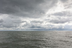 Moody skies. Nordic sea - moody sky and heavy clouds Royalty Free Stock Image
