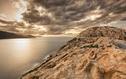 Moody skies over the lighthouse at Ile Rousse in Corsica Royalty Free Stock Photo