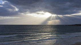 Moody Sky above the wide great sea. With powerful sunbeams breaking through the cloudscape Royalty Free Stock Photos