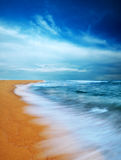 Moody sky and beach. Slow shutter Royalty Free Stock Image
