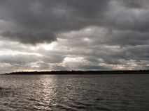Free Moody Sky Clouds Autumn Winter Grey Dark Bay Ocean River Estuary Royalty Free Stock Photos - 109437208