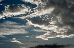 Moody sky and fluffy clouds Royalty Free Stock Photo