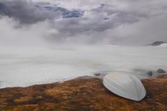 Moody sky by frozen lake. Frozen lake by mountain road Hardanger in Norway Stock Image