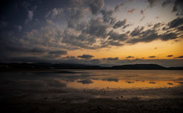 Moody sky and lake. Royalty Free Stock Images