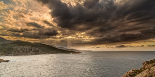 Moody sky over the coast of Corsica near Ile Rousse Stock Images