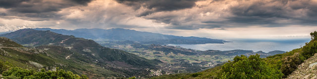 Moody sky over gulf of St Florent in Corsica Stock Image
