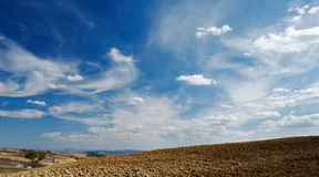 Moody sky on plowed land royalty free stock photos