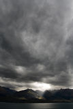 Moody Sky Portrait. Dark moody sky over mountain range, new zealand Royalty Free Stock Images