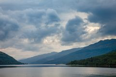 Dramatic sky over Loch Long Argyll and Bute Scotland UK. Moody sky with stormy clouds over Sea Loch Long in Argyll and Bute ,Scotland, UK Royalty Free Stock Image