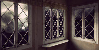 Moody sky through windows Royalty Free Stock Photos