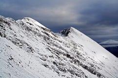Moody snow covered Beinn Eighe or Ruadh-stac Mòr Torridon Stock Photos