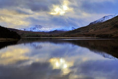 Moody Snowdonia reflected in Peaceful Llyn Mymbyr Snowdonia. Moody Snowdonia reflected in Peaceful Llyn Mymbyr Capel Curig Snowdon Wales Stock Images