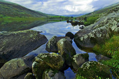 Moody Snowdonia reflected in Peaceful Llyn Mymbyr Snowdonia Royalty Free Stock Images