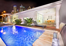 A moody and stylish image of a house pool with beautiful city be Royalty Free Stock Photography