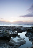 Moody Sunset. Peaceful Beach overlooking a sunset stock photography