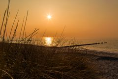 Moody sunset at the Baltic Sea. With beautiful colors in Rostock, Germany stock image