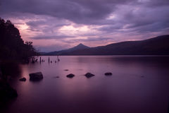 Moody sunset over loch rannoch. Moody sunset taken from the shores of loch Rannoch Royalty Free Stock Photos