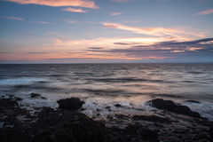 Moody sunset seascape. With atmospheric waves along the Somerset coastline in England Stock Image