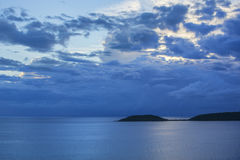 Moody sunset sky over tropical sea Stock Images