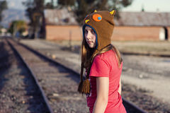 Moody teen girl on the railroad tracks Royalty Free Stock Images