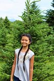Moody Tree Farm. School age, diverse, happy girl at Moody Tree Farm, located near Saranac Lake, New York royalty free stock photo