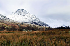 Moody Tryfan showing the Heather Terrace. Snow clouds over Moody Tryfan, Snowdonia Wales royalty free stock photos