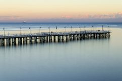Moody twilight over pier in gdynia orlowo on Baltic sea in poland. Europe Stock Photos