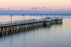 Moody twilight over pier in gdynia orlowo on Baltic sea in poland. Europe Stock Photo