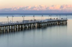 Moody twilight over pier in gdynia orlowo on Baltic sea in poland. Europe Royalty Free Stock Images
