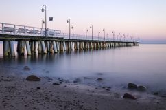 Moody twilight over pier in gdynia orlowo on Baltic sea in poland. Europe Royalty Free Stock Image