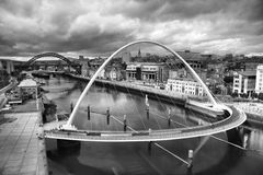 Moody Tyne. Newcastle and Gateshead quaysides along the banks of the River Tyne, Northeast England Stock Photography